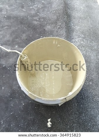 Paintbrush on top of color paint can for diy home decorating - stock photo