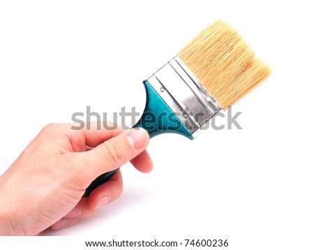 Paintbrush with arm isolated on white. - stock photo
