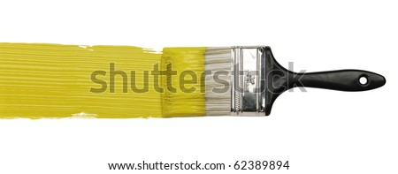Paintbrush with yellow paint isolated over white background - stock photo