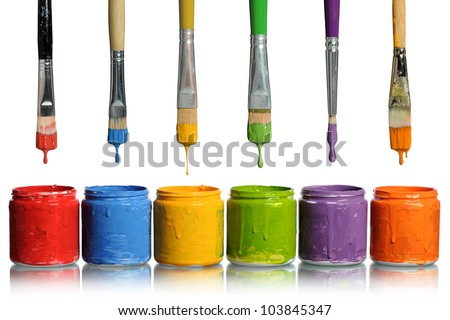 Paintbrushes dripping paint of various colors into containers - stock photo