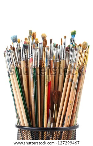 paintbrushes in black holder cup on white - stock photo