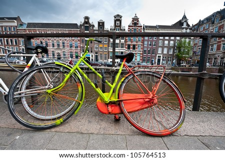 Painted Bicycle on the Embankment of Amsterdam - stock photo
