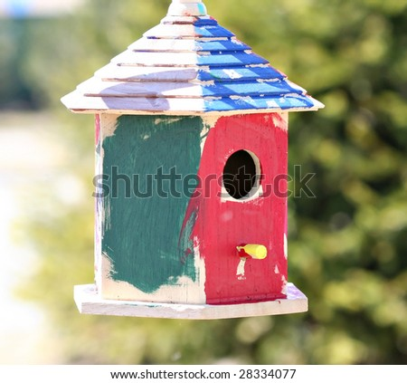 Painted bird house - stock photo
