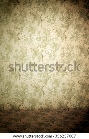 Painted canvas or muslin fabric cloth studio backdrop or background, suitable for use with portraits, products and concepts. Grungy green, tan, brown, and off-white or ecru. - stock photo