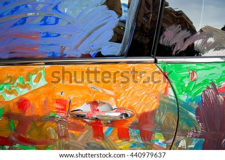 painted car with a mix of colours by hooligans - stock photo