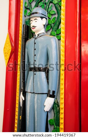 painted carved wood of temple door in Bangkok - stock photo
