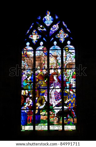 Painted Church Windows showing various religious motives - stock photo