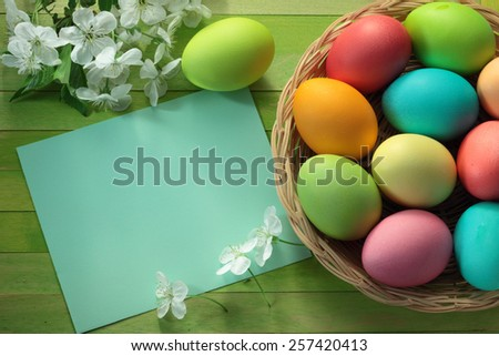 Painted Easter eggs basket and cherry tree blossom flowers  - stock photo