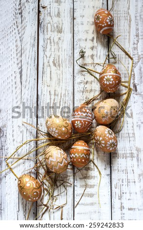 painted Easter eggs on a white wooden background - stock photo