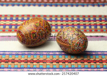Painted Easter eggs on traditional Easter cloth - stock photo