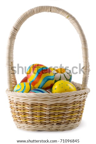 Painted eggs in the basket - stock photo