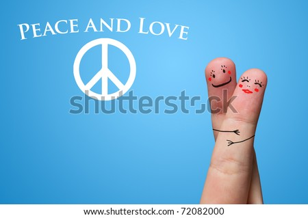 Painted finger smiley, peace and love theme - stock photo