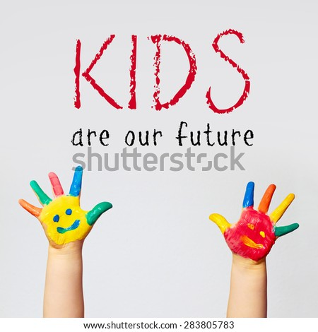 painted hands of little child - kids are our future - stock photo