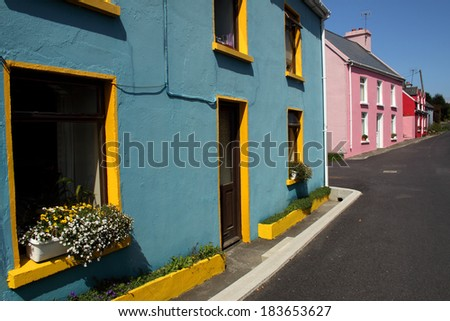 Painted houses in West Cork village in Ireland Europe. - stock photo