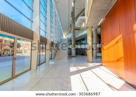 Painted in brown. Abstract fragment of the architecture of modern lobby, hallway of the luxury hotel, shopping mall, business center in Vancouver, Canada. Interior design. - stock photo