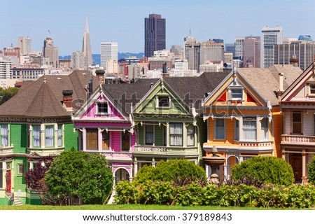 Painted ladies from Alamo square park over San Francisco skyline during the day  - stock photo