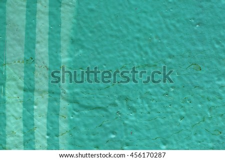 Painted lines on dirty green wall surface. Abstract background. - stock photo