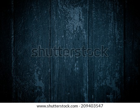 painted old wooden wall.dark blue background - stock photo