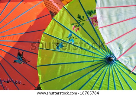 painted parasols in an outdoor market - stock photo