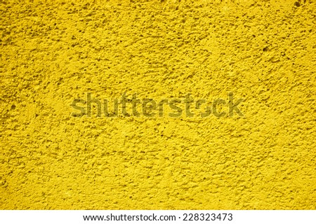 Painted sandstone wall. - stock photo