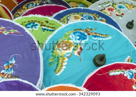 painted silk umbrella cottage industry in Thailand - stock photo