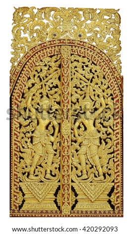 Painted wood carving on windows of Thai temple - stock photo