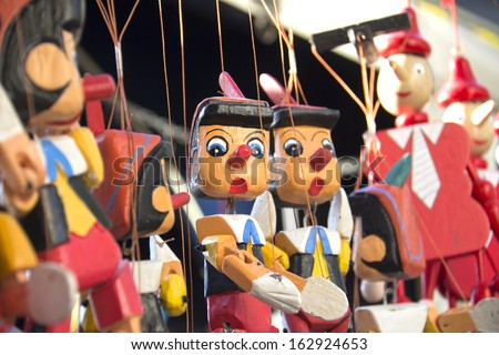 Painted wooden, the figure of Pinocchio  - stock photo