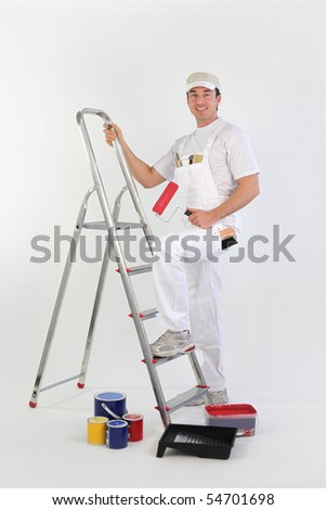 Painter climbing a ladder on white background - stock photo
