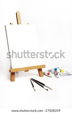 painter easel, brushes and acrylic colors on a white background - stock photo