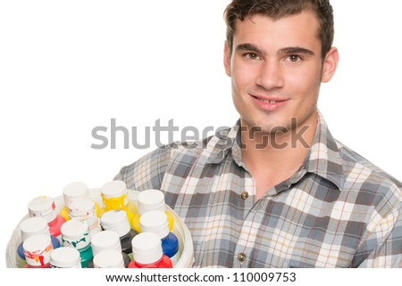 Painter in the studio in front of white background - stock photo