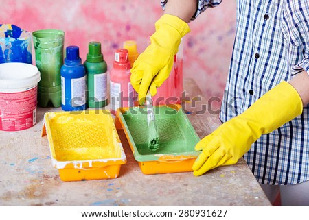 Painter is preparing to paint the walls - stock photo