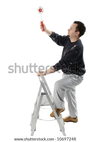 Painter on ladder holding a paint roller - stock photo