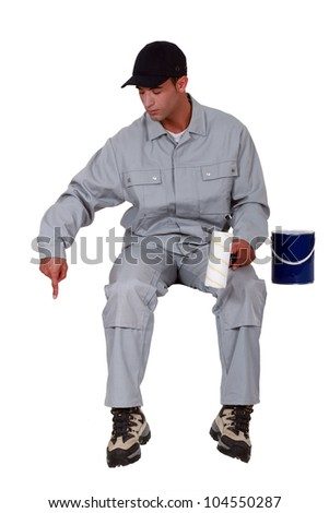 Painter pointing down - stock photo