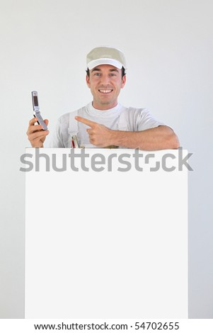 Painter with a phone and panel on white background - stock photo
