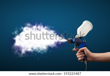 Painter with airbrush gun and white magical smoke concept - stock photo