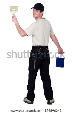Painter with brush and paint bucket - stock photo