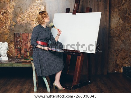painter woman with blank canvas - stock photo