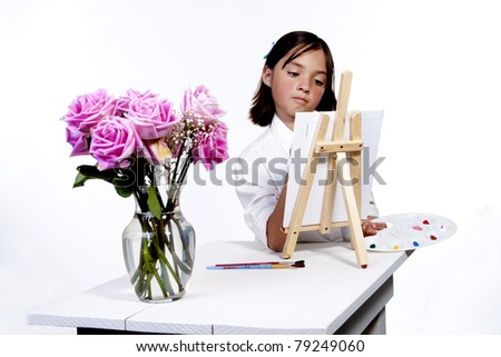 Painting a picture of flowers. - stock photo