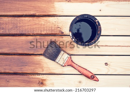 painting a wooden table using paintbrush  - stock photo