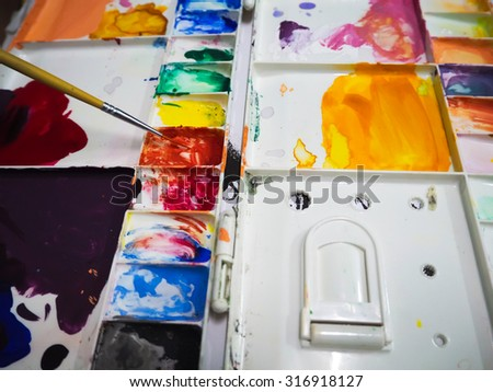 Painting art with water color palette - stock photo