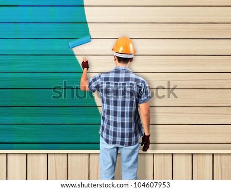 painting avd paint brush house on wood - stock photo