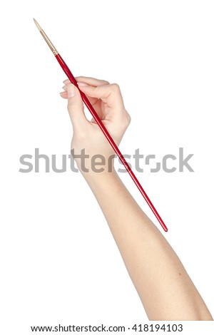 painting brush in a hand isolated on white background. artist tool - stock photo