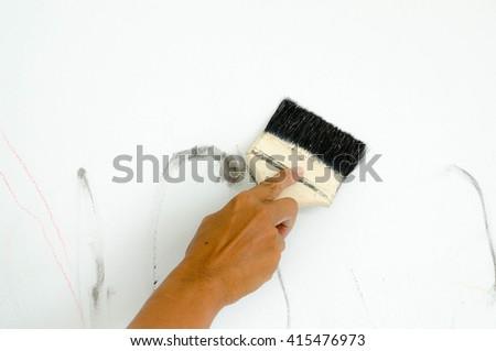 Painting brush in the hand - stock photo