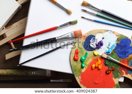 painting brushes and palette close up - stock photo