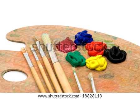 painting brushes and palette on white background - stock photo