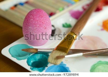Painting colorful easter egg - stock photo
