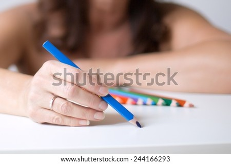 painting, focus on painting hand  - stock photo
