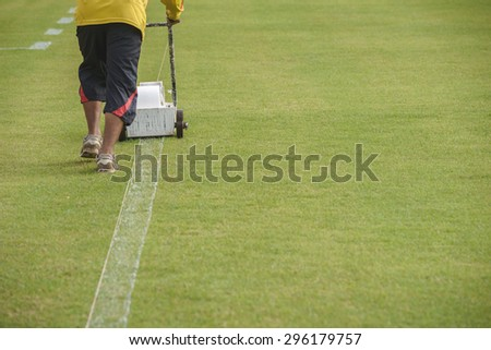 Painting lines on the field - stock photo