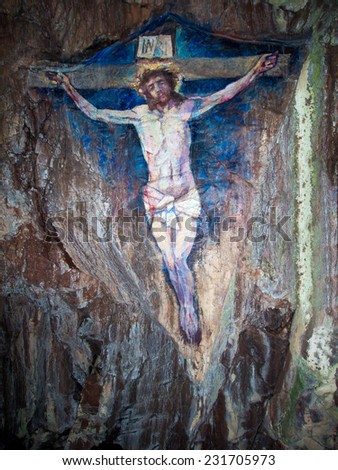 Painting of the crucifixion of Jesus Christ on Davaar Island,Scotland - stock photo