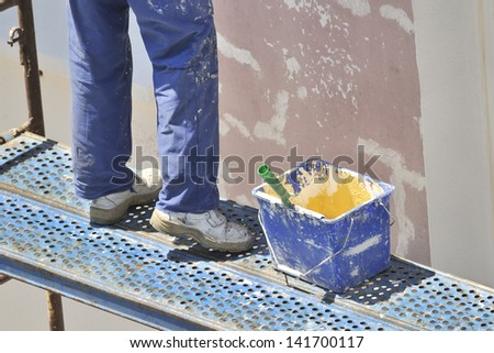 painting the exterior of the house. Works - stock photo